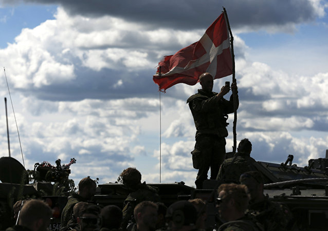Danish soldiers during a military exercise ' Saber Strike 2014 ' at the Rukla military base some 120 km. (75 miles) west of the capital Vilnius, Lithuania, Tuesday, June 17, 2014.