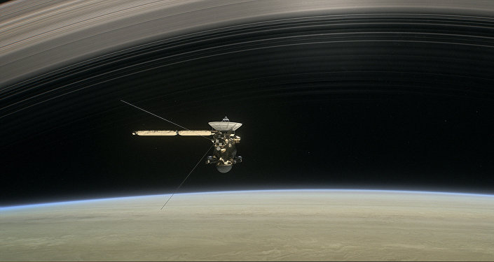 This image made available by NASA in April 2017 shows a still from the short film Cassini's Grand Finale, with the spacecraft diving between Saturn and the planet's innermost ring