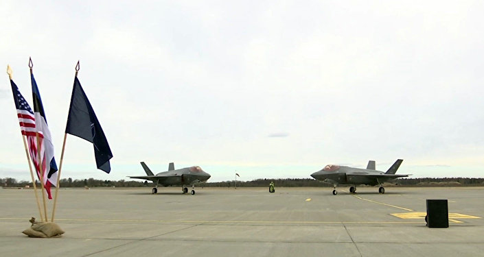 In this image made from video, two F35A fighter jets sit on the tarmac at the Amari Airbase in Harjumaa, Estonia, Tuesday, April 25, 2017