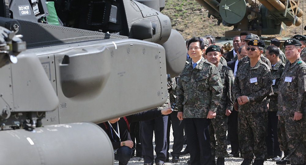 South Korea's acting President and Prime Minister Hwang Kyo-ahn, left, inspects a variety of fire arms during a South Korea-U.S. joint military live-fire drills at Seungjin Fire Training Field in Pocheon, South Korea, near the border with the North Korea, Wednesday. April 26, 2017