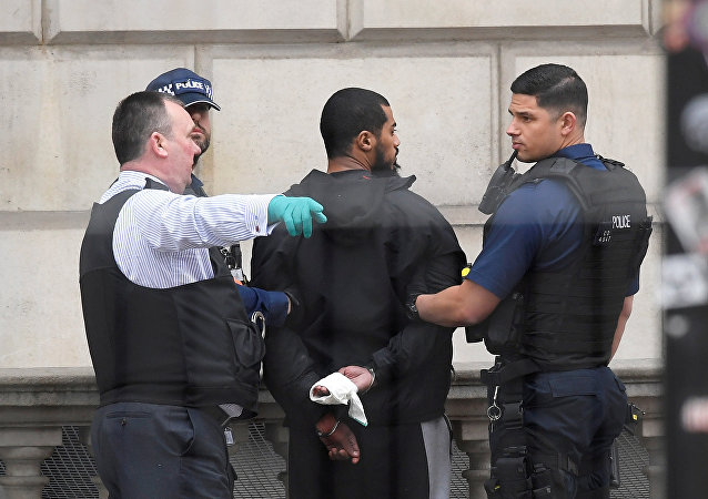 A man is held by police in Westminster after an arrest was made on Whitehall in central London, Britain, April 27, 2017