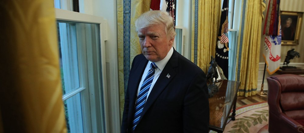U.S. President Donald Trump stands in the Oval Office following an interview with Reuters at the White House in Washington, U.S., April 27, 2017