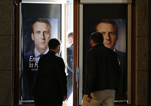 Staff members set up the hall before Emmanuel Macron, head of the political movement En Marche !, or Onwards !, and candidate for the 2017 presidential election, attends a campaign rally in Chatellerault, France, April 28, 2017