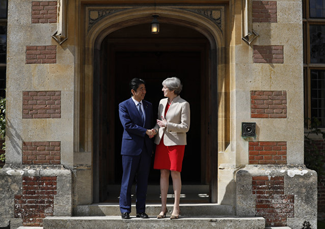 Britain's Prime Minister Theresa May welcomes Prime Minister Shinzo Abe of Japan to Chequers near Wendover, England, Friday, April 28, 2017