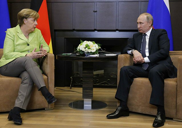 German Chancellor Angela Merkel talks to Russian President Vladimir Putin during their meeting at the Bocharov Ruchei state residence in Sochi, Russia, May 2, 2017