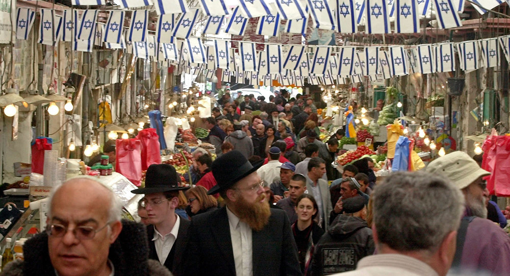 Israelis shop before the Jewish holiday of Passover in Jerusalem's Mahane Yehuda food market.