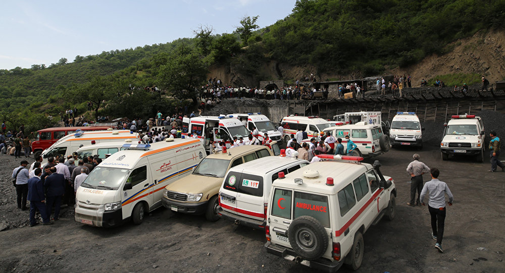 Rescue workers gather at the scene following an explosion in a coal mine in Azadshahr, in northern Iran, leaving dozens of miners trapped on May 3, 2017