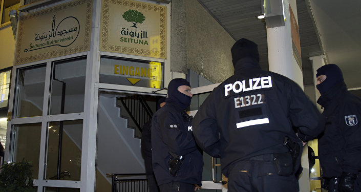(File) Police officers guard the 'Seituna' cultural society in Berlin, Germany, Thursday, Nov. 26, 2015