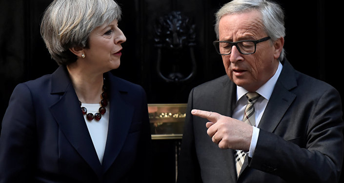 Britain's Prime Minister Theresa May welcomes Head of the European Commission, President Jean-Claude Juncker to Downing Street in London, Britain April 26, 2017.