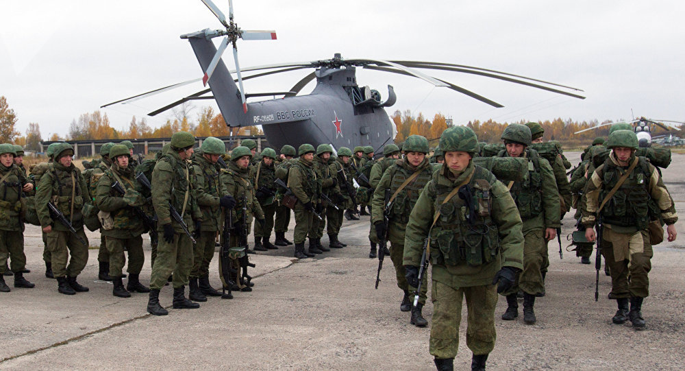 Russian paratroopers gathered round a Mi-26 helicopter during drills in the country's Western Military District. File photo