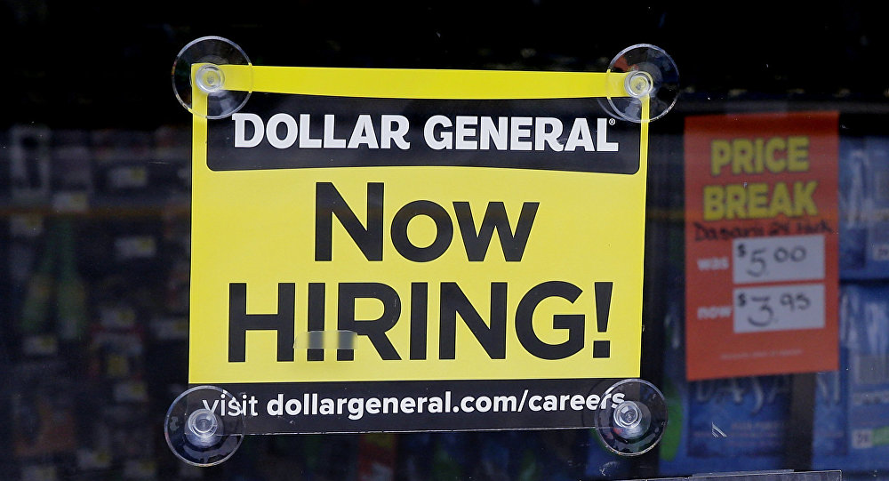In this Wednesday, May 18, 2016, photo, a Now Hiring sign hangs in the window of a Dollar General store in Methuen, Mass.