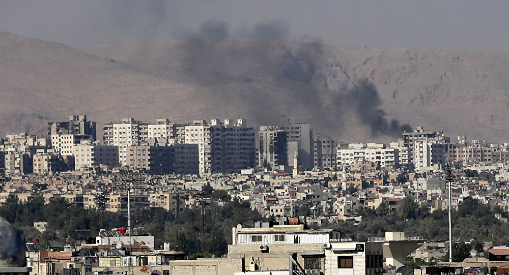 Hundreds of Syrian rebels start evacuating Damascus district