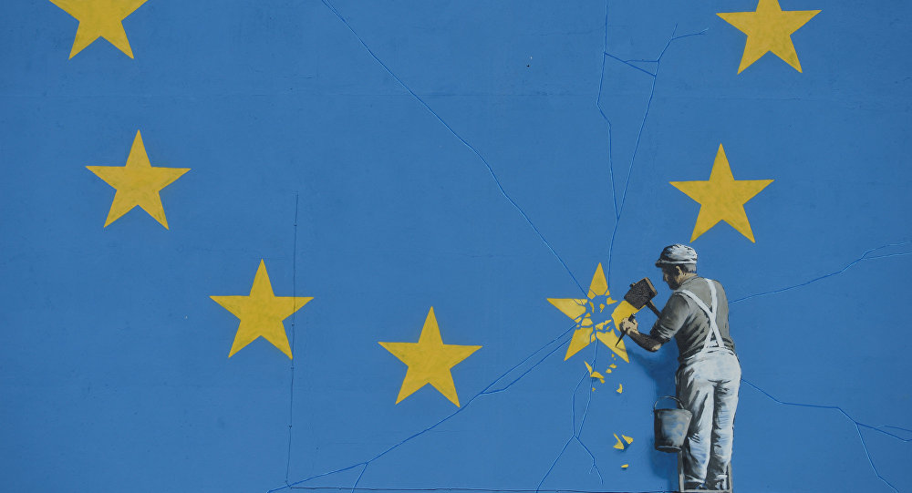 A section of an artwork attributed to street artist Banksy, depicting a workman chipping away at one of the 12 stars on the flag of the European Union, is seen on a wall in the ferry port of Dover.