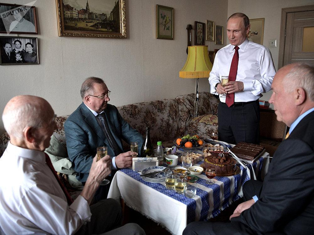 Russian President Vladimir Putin visited former head of the KGB intelligence group in Dresden Lazar Matveev, left, in Zhulebino