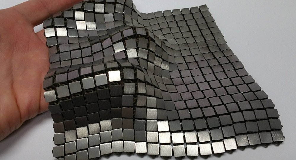 This metallic space fabric was created using 3-D printed techniques that add different functionality to each side of the material.