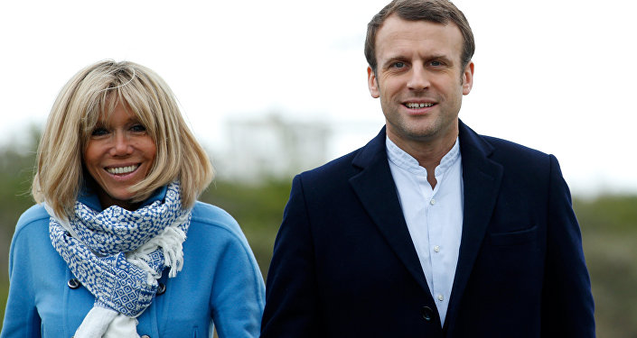 Emmanuel Macron and his wife Brigitte Trogneux pose for the photograph in Le Touquet, France, April 22, 2017, on the eve of the first round of presidential election.