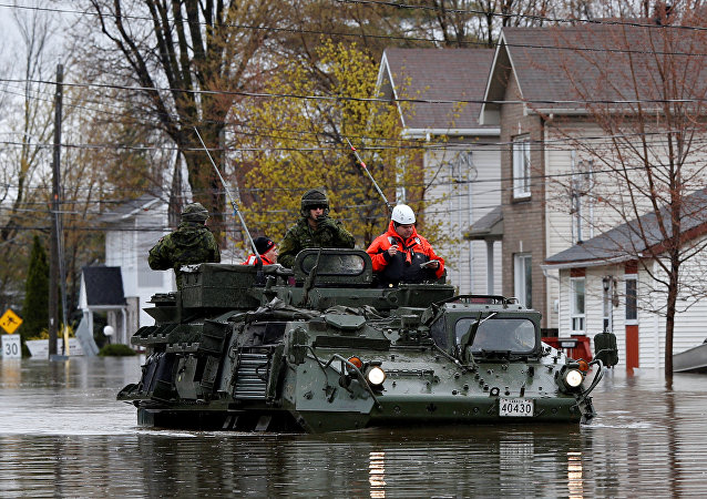 Canadian soldiers inspect a flooded residential area in Gatineau, Quebec, Canada, May 7, 2017.