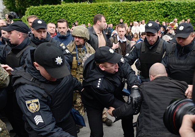 Ukrainian riot police officers block supporters of far-right parties who tried to prevent the Immortal Regiment march, during the Victory Day celebrations in Kiev, Ukraine