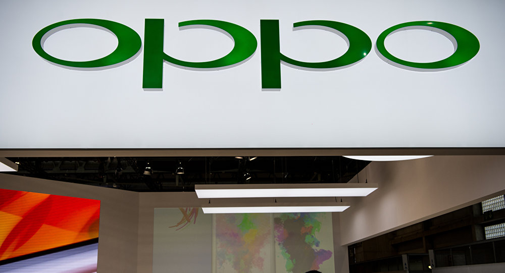 People visit the Oppo stand at the Mobile World Congress on the third day of the MWC in Barcelona