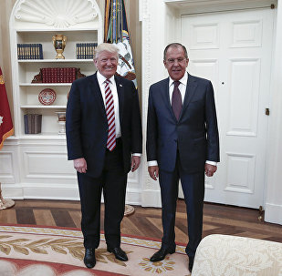 A handout photo made available by the Russian Foreign Ministry on May 10, 2017 shows US President Donald J. Trump (L) posing with Russian Foreign Minister Sergei Lavrov during a meeting at the White House in Washington, DC.