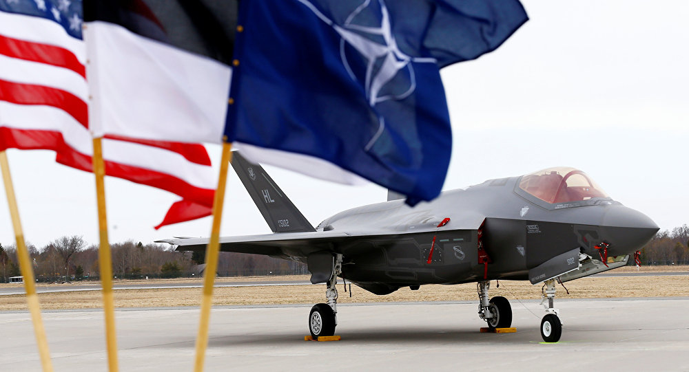 U.S., Estonia's and NATO flags flutter next to the U.S. Air Force F-35A Lightning II fighter in Amari air base, Estonia, April 25, 2017