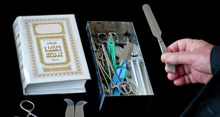Rabbi presenting his surgical instruments for circumcision (File)