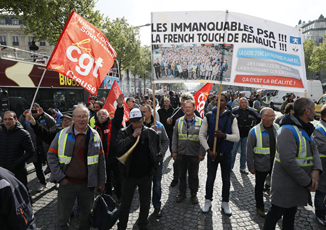Employees of GM&S, a supplier of car manufacturers, march during a demonstration against job cuts organised by the CGT and FO trade unions in Paris on April 19, 2017
