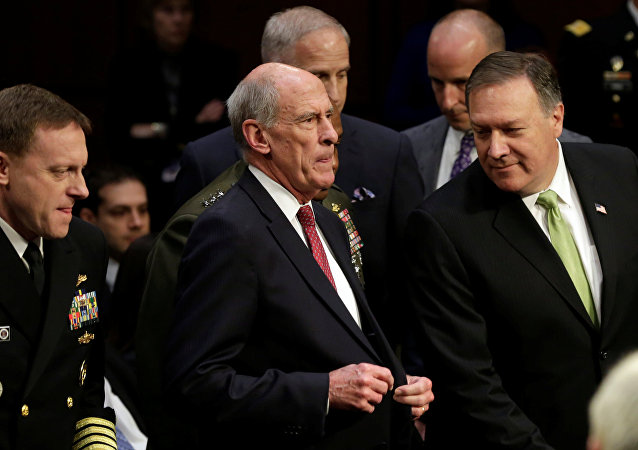 L-R) NSA Director Adm. Mike Rogers, Director of National Intelligence Daniel Coats and CIA Director Mike Pompeo arrive to testify before a Senate Intelligence Committee hearing on Capitol Hill in Washington, U.S., May 11, 2017
