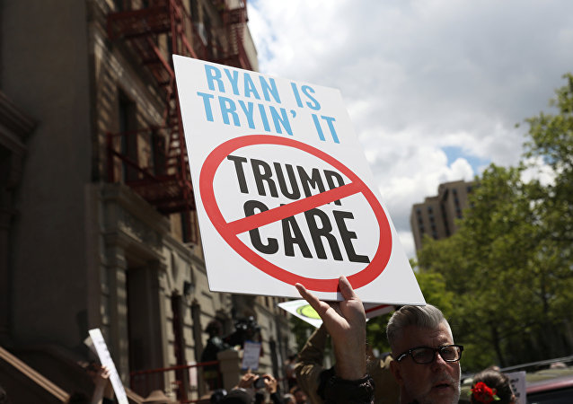 Demonstrators and healthcare activists rally before the visit of Speaker of the U.S. House of Representatives Paul Ryan at the Success Academy 1 charter school in Harlem, New York, U.S., May 9, 2017