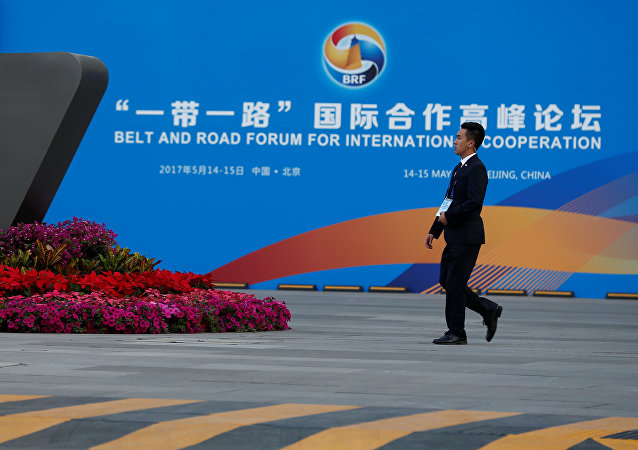 A man walks past the China National Convention Center, a venue of the upcoming Belt and Road Forum in Beijing, China, May 12, 2017