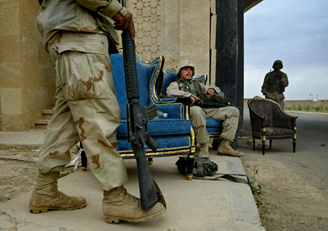 U.S. Marines, using luxurious armchairs, man one of the entrances to Saddam Hussein's presidential palace compound in the northern Iraqi town of Tikrit, Tuesday April 15, 2003
