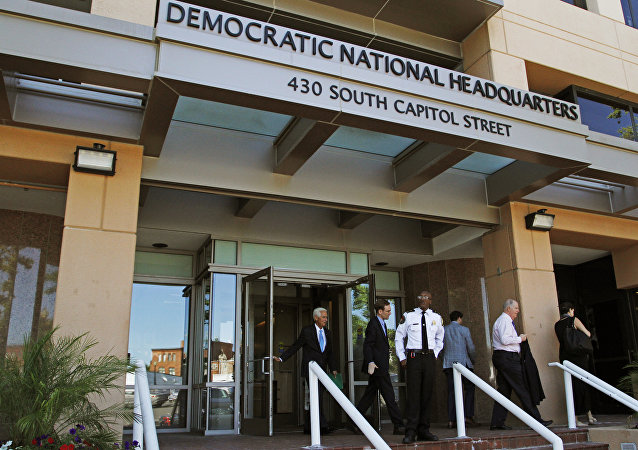 People stand outside the Democratic National Committee (DNC) headquarters in Washington, Tuesday, June 14, 2016