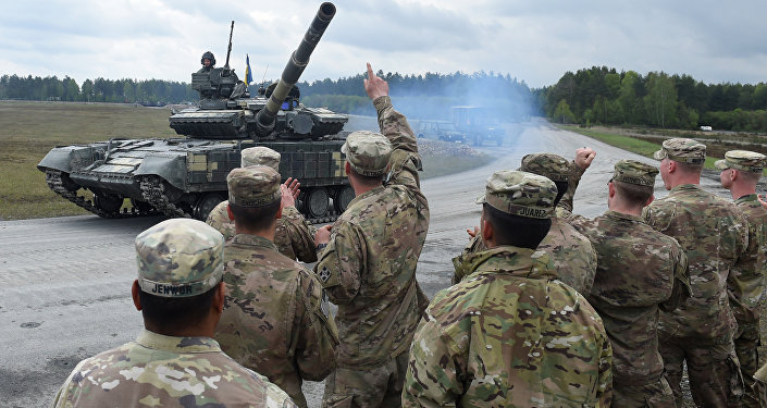 US soldiers welcome the crew of an Ukrainian tank type 'T-64BM' prior the friendship shooting of several nations during the exercise 'Strong Europe Tank Challenge 2017' at the exercise area in Grafenwoehr, near Eschenbach, southern Germany, on May 12, 2017