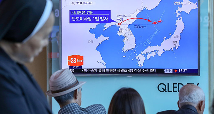 People watch a news report on North Korea firing a ballistic missile, at a railway station in Seoul, South Korea, May 14, 2017