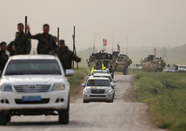Kurdish fighters from the People's Protection Units (YPG) head a convoy of U.S military vehicles in the town of Darbasiya next to the Turkish border, Syria April 28, 2017