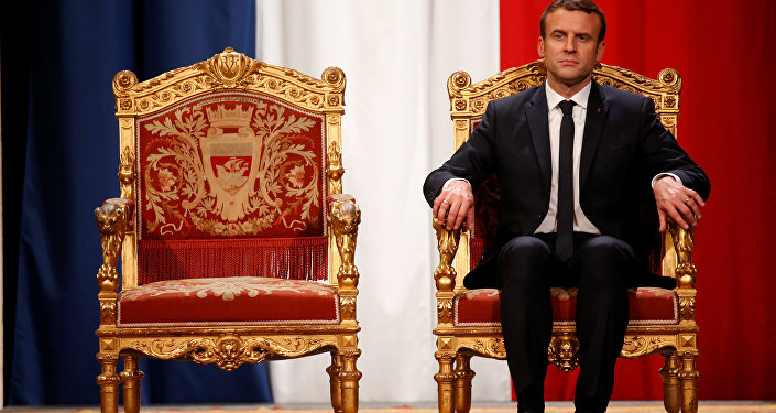 French President Emmanuel Macron listens as Paris Mayor Anne Hidalgo delivers her speech during a ceremony at the Hotel de Ville in Paris, France, May 14, 2017.