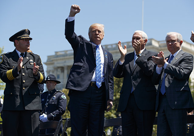 President Donald Trump pumps his fist.