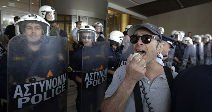 Protesters chant slogans in front of Riot police cordon outside a hotel where bailout inspectors were due to resume talks with the Greek government in Athens, on Monday, May 1, 2017.