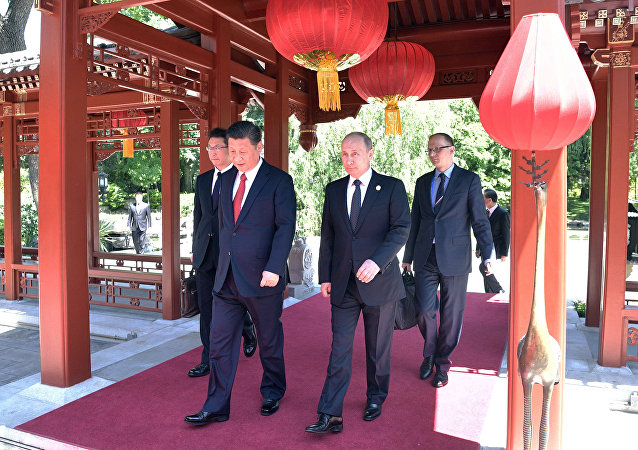 May 14, 2017. President Vladimir Putin and President of China Xi Jinping, right, during a walk after the Russia-China talks at the One Belt, One Road international forum.