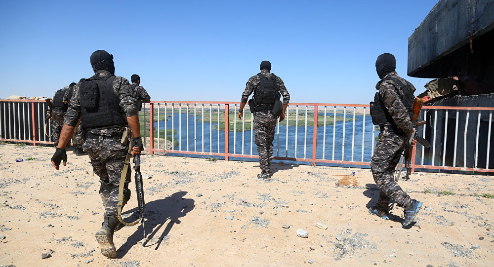 Special forces from the US-backed Syrian Democratic Forces (SDF), made up of an alliance of Arab and Kurdish fighters, inspect the Tabqa dam, on May 12, 2017, after it had been recaptured earlier this week along with the adjacent city.