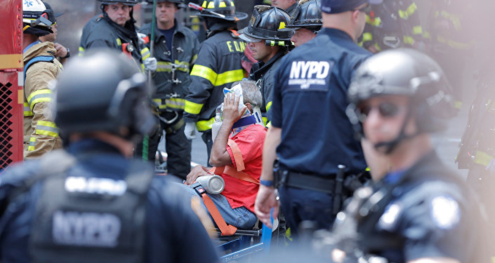 First responders tend to an injured pedestrian after a vehicle struck pedestrians on a sidewalk in Times Square in New York, U.S., May 18, 2017.