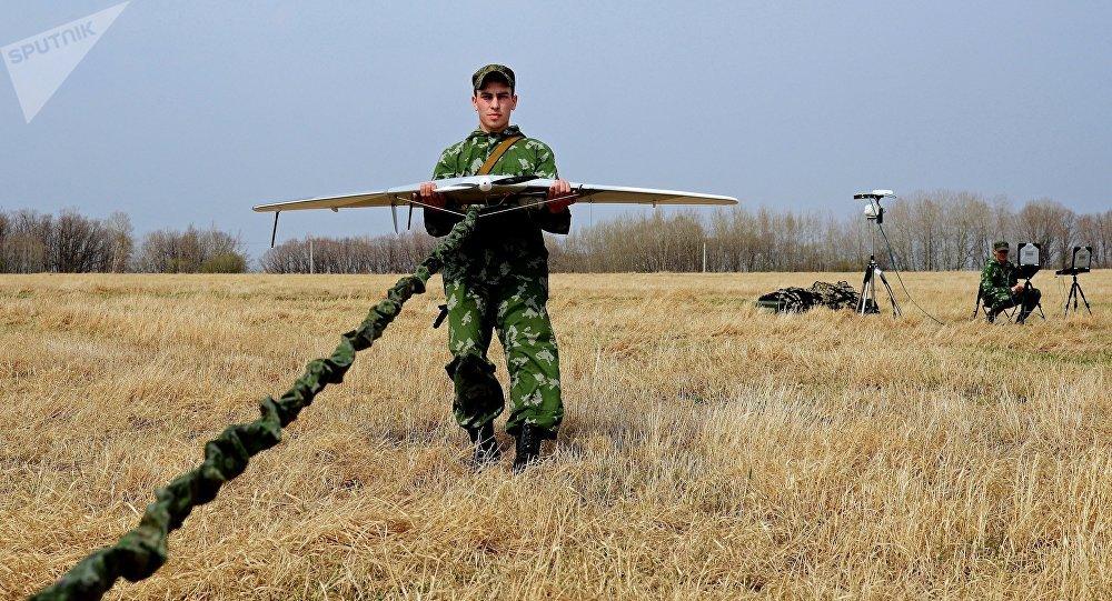 A serviceman of the reconnaissance unit of an Eastern Military District motorized rifle formation launches a drone during special tactical training at the Anastasyevsky base in the Khabarovsk Territory