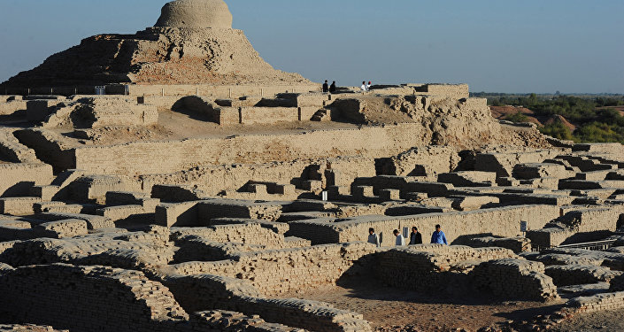 In this photograph taken on February 9, 2017, visitors walk through the UNESCO World Heritage archeological site of Mohenjo Daro some 425 kms north of the Pakistani city of Karachi.