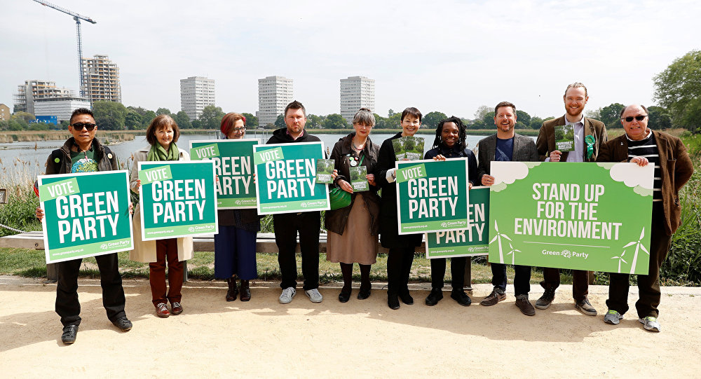 Co-leader of the Green Party, Caroline Lucas, (5th R) poses for a photograph with party members following the launch of their general election manifesto, in London, Britain May 11, 2017