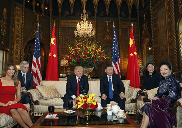 President Donald Trump and Chinese President Xi Jinping, sit with their wives, first lady Melania Trump, left, and Chinese first lady Peng Liyuan, right, before a meeting at Mar-a-Lago, Thursday, April 6, 2017, in Palm Beach, Fla