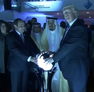U.S. President Donald Trump places his hands on a glowing orb as he tours with other leaders the Global Center for Combatting Extremist Ideology in Riyadh, Saudi Arabia May 21, 2017