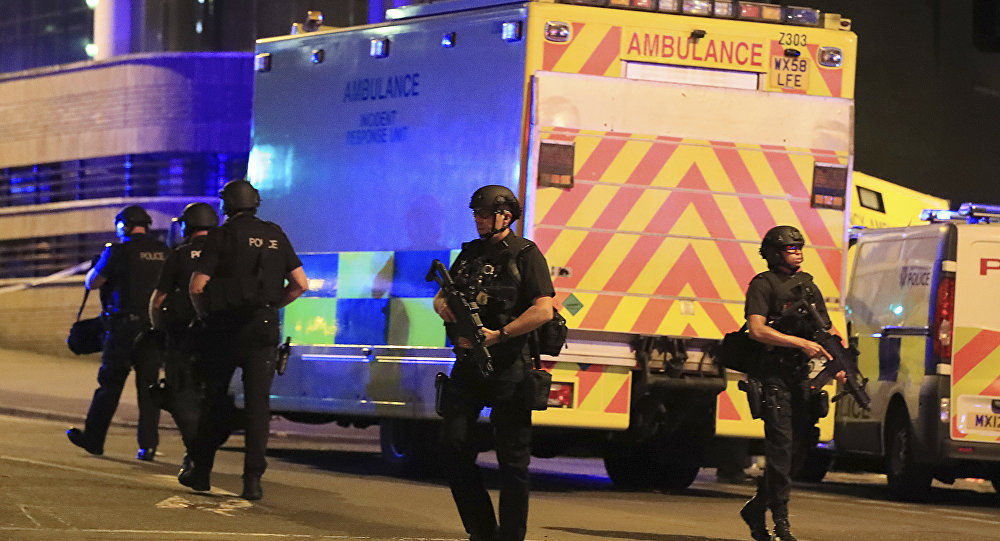 Police stand near an ambulance at Manchester Arena after reports of an explosion at the venue during an Ariana Grande concert on Monday, May 22, 2017.