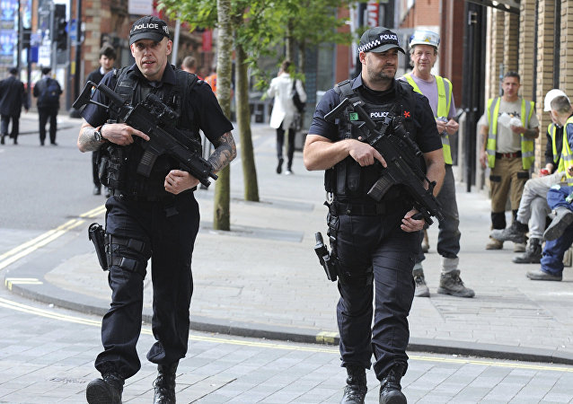 Armed police patrol the streets near to Manchester Arena in central Manchester, England, Tuesday May 23, 2017.