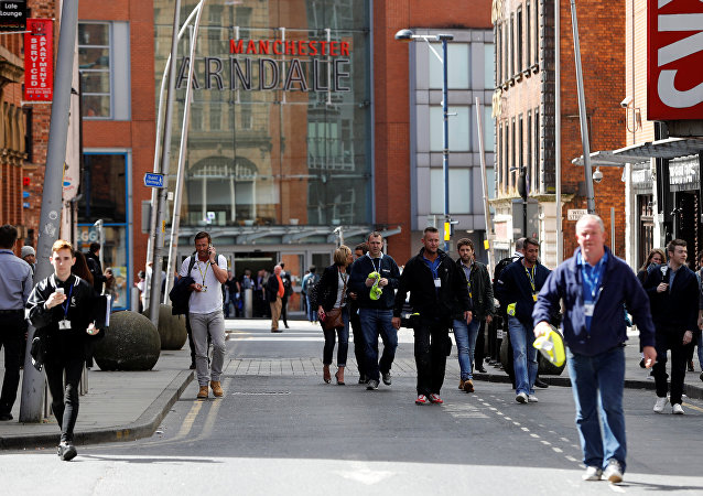 People rush out of the Arndale shopping centre as it is evacuated in Manchester, Britain May 23, 2017.