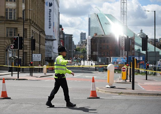 A police officer potrols a cordon near to the Manchester Arena in Manchester, northwest England on May 23, 2017